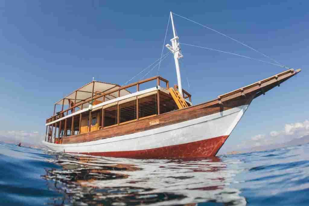 Yolande, the most comfortable dive boat in Labuan Bajo sailing through the Komodo National Park on a calm sunny day.