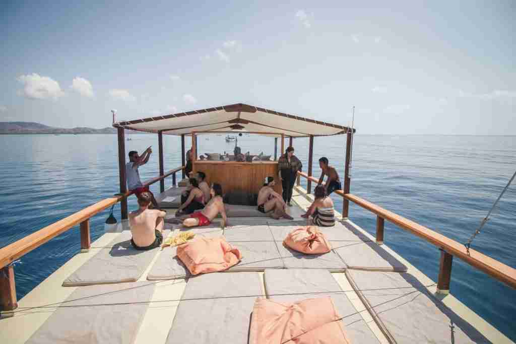 The top deck of Yolande, the most comfortable dive boat in Labuan Bajo, with all the mattresses available to relax.