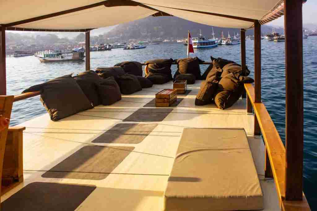 The top deck of Yolande, the most comfortable dive boat in Labuan Bajo, with all the bean bags available to relax.